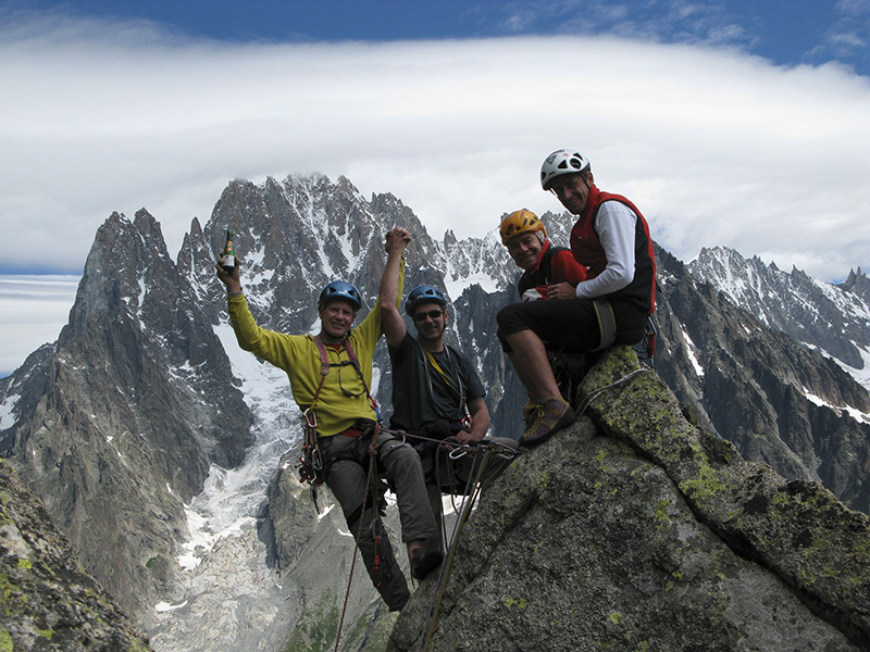 Michel Piola, Gerard Hopfgartner, Pascal Strappazzon and Vincent Sprungli celebrate the 25th anniversary of Marchand de Sable on Tour Rouge, one of the most famous climbs first ascended by Piola. - Photo by Pascal Strappazzon e Vincent Sprüngli