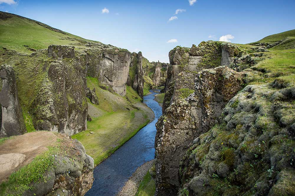 Island, 25.6.–9.7.2017. - Fjaðrárgljúfur canyon is a canyon in south east Iceland which is up to 100 m deep and about 2 kilometers long, with the Fjaðrá river flowing through it. The canyon has steep walls and winding water. Its origins dates back to the